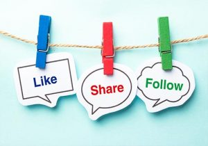 Like, share, and follow images hanging from string.