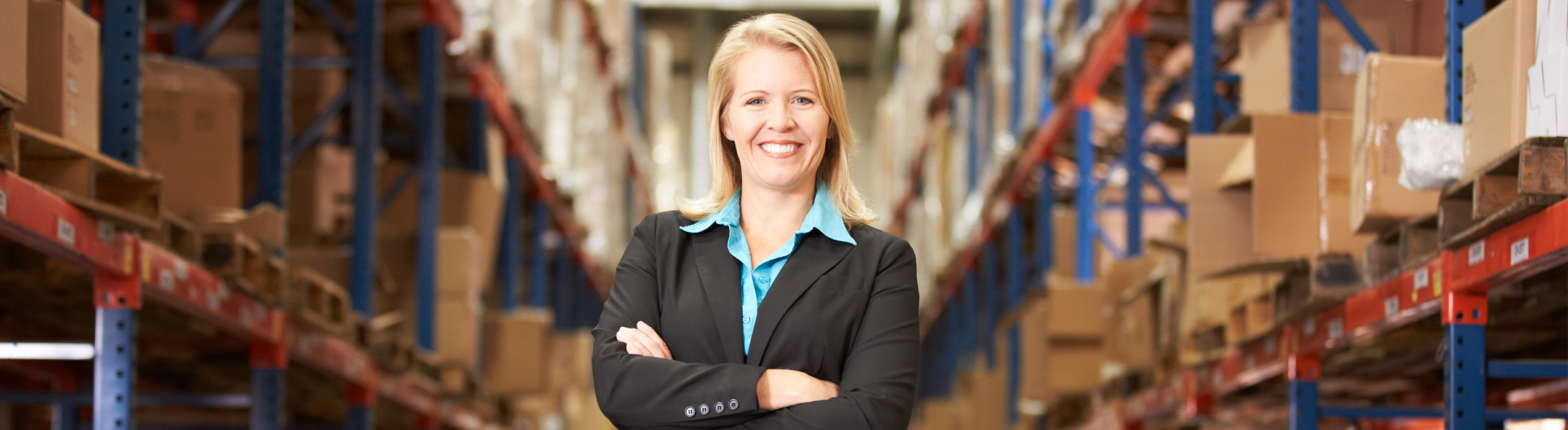 ecommerce owner smiling in her warehouse